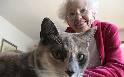 senior female with her pet cat for pet care offered by AllCare, an in-home care agency located in Summerville, SC